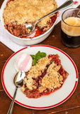Homemade strawberry and rhubarb crumble pie. Strawberry and rhubarb pie crumble topping, served with ice cream Stock Photos