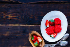 Homemade strawberry sorbet. Delicious strawberry sorbet in bowl with fresh berries on vintage wooden background, top view, copy space. Healthy raw vegan summer Stock Photos