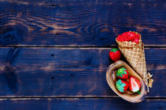 Homemade strawberry sorbet. Top view of strawberry sorbet with fresh berries in waffle cone on vintage wooden background, copy space. Healthy raw vegan summer royalty free stock photography