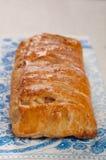 Homemade Strudel cakes on baking pan Stock Photos