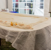 Homemade strudel dough on linen tablecloth ready for making pie according to the traditional recipe. Stock Images