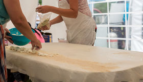 Homemade strudel dough on linen tablecloth ready for making pie according to the traditional recipe. Stock Photos