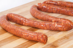 Homemade stuffed sausage on the kitchen wooden board.  Stock Image