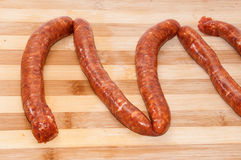 Homemade stuffed sausage on the kitchen wooden board Stock Image