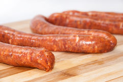 Homemade stuffed sausage on the kitchen wooden board.  Royalty Free Stock Photo