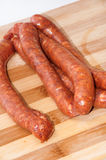 Homemade stuffed sausage on the kitchen wooden board Stock Images