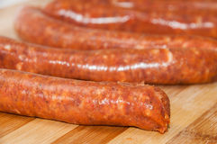 Homemade stuffed sausage on the kitchen wooden board Stock Photo