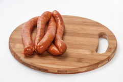 Homemade stuffed sausage on the round wooden board.  Royalty Free Stock Photography