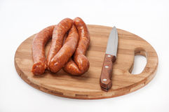 Homemade stuffed sausage on the round wooden board Royalty Free Stock Photography