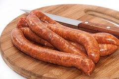Homemade stuffed sausage on the round wooden board Royalty Free Stock Photos