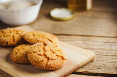 Homemade sugar cookies with honey on wooden board Royalty Free Stock Photo