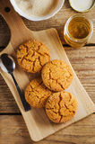 Homemade sugar cookies with honey on wooden board Stock Image