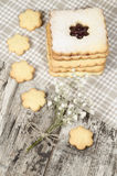 Homemade sugar cookies with jam decorated with flowers. Royalty Free Stock Image