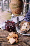 Homemade sugar honey cookies, raspberry jam in jar, bread and butter, knife, on a wooden background. Breakfast concept. Homemade sugar honey cookies, raspberry Stock Images