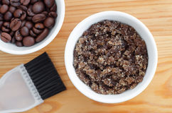 Homemade sugar, olive oil and ground coffee face and body scrub. Diy cosmetics. Royalty Free Stock Image