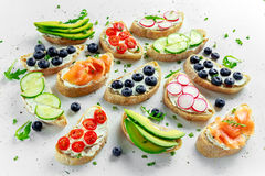 Homemade summer toast with cream cheese Smoked Salmon, Blueberries, Radish, Cucumber, Avocado and cress salad. Fresh. Healthy concept food Royalty Free Stock Image