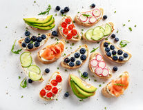 Homemade summer toast with cream cheese Smoked Salmon, Blueberries, Radish, Cucumber, Avocado and cress salad. Fresh. Healthy concept food Stock Image