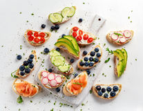 Homemade summer toast with cream cheese Smoked Salmon, Blueberries, Radish, Cucumber, Avocado and cress salad. Fresh. Healthy concept food Stock Photos