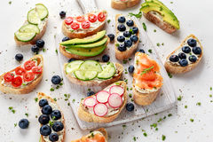 Homemade summer toast with cream cheese Smoked Salmon, Blueberries, Radish, Cucumber, Avocado and cress salad. Fresh. Healthy concept food Stock Photo
