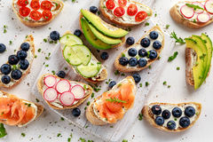 Homemade summer toast with cream cheese Smoked Salmon, Blueberries, Radish, Cucumber, Avocado and cress salad. Fresh. Healthy concept food Royalty Free Stock Images