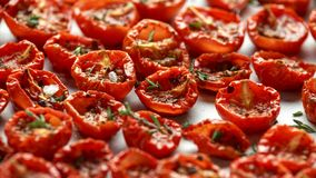 Homemade Sun Dried Tomatoes with thyme and sea salt.  royalty free stock photo