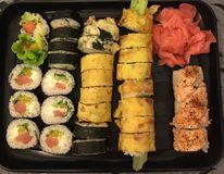 Homemade sushi on black plate Royalty Free Stock Images