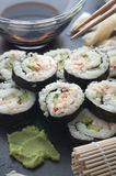 Homemade Sushi. Homemade lobster and cucumber sushi served with tamari and wasabi stock photo