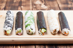 Homemade sushi rolls. On cutting board royalty free stock photography