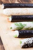 Homemade sushi rolls. On cutting board Royalty Free Stock Image