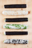 Homemade sushi rolls on cutting board. Homemade sushi rolls on wooden cutting board royalty free stock photo