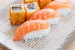 Homemade sushi with salmon, cream cheese Philadelphia, Japanese Royalty Free Stock Images