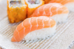 Homemade sushi with salmon, cream cheese Philadelphia, Japanese Royalty Free Stock Images