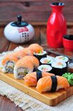 Homemade sushi with salmon, cream cheese Philadelphia, Japanese omelette, cucumber and wasabi. selective focus Royalty Free Stock Images