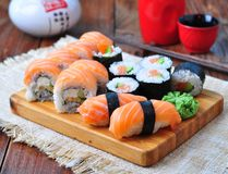 Homemade sushi with salmon, cream cheese Philadelphia, Japanese omelette, cucumber and wasabi. selective focus Stock Image