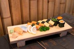 Homemade sushi with salmon, cream cheese Philadelphia, Japanese omelette Royalty Free Stock Photos