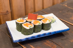 Homemade sushi with salmon, cream cheese Philadelphia, Japanese. Stock Photography