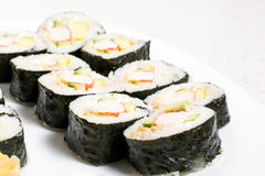 Homemade sushi in a white plate with wasabi and Royalty Free Stock Images