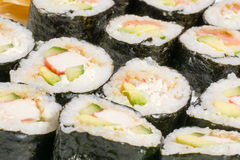 Homemade sushi in a white plate with wasabi and Royalty Free Stock Image