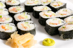 Homemade sushi in a white plate with wasabi and Stock Photos