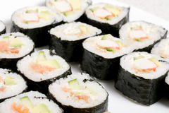 Homemade sushi in a white plate with wasabi and Royalty Free Stock Photo