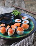 Homemade sushi with wild salmon, shrimp, cucumber and seaweed. selective focus Royalty Free Stock Photo