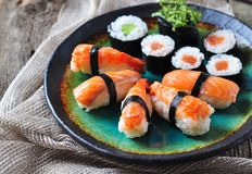 Homemade sushi with wild salmon, shrimp, cucumber and seaweed. selective focus Stock Photos