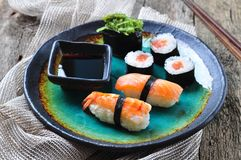 Homemade sushi with wild salmon, shrimp, cucumber and seaweed. selective focus Royalty Free Stock Photography