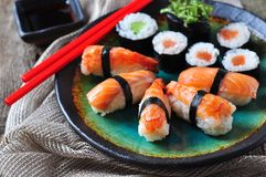 Homemade sushi with wild salmon, shrimp, cucumber and seaweed. selective focus Stock Photography