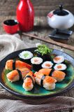 Homemade sushi with wild salmon, shrimp, cucumber and seaweed. selective focus Royalty Free Stock Images