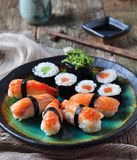 Homemade sushi with wild salmon, shrimp, cucumber and seaweed. selective focus Royalty Free Stock Image