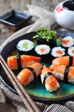Homemade sushi with wild salmon, shrimp, cucumber and seaweed. selective focus Stock Images