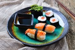Homemade sushi with wild salmon, shrimp, cucumber and seaweed. selective focus Stock Photo