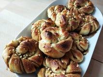 Homemade Swedish cardamom and cumin rolls on a white plate. stock photos