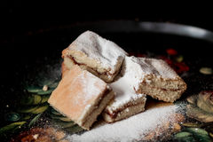 Homemade sweet cookies with jam, sprinkled with powdered sugar, close up Stock Photos